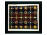 An Amish Pieced & Quilted Cotton Coverlet, Late 19th Century Prints
