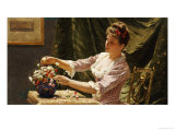 A Young Woman Arranging Flowers Giclee Print by Emile Claus