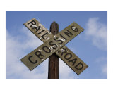 Railroad Crossing Sign with Mold and Bullet holes against Blue Sky Photographic Print by James Davidson