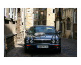 Cat asleep on a Jaguar in Le Mans Photographic Print by Craig M Fisher