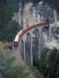 Passenger Train on Rock Bridge, Switzerland Photographic Print by Gavriel Jecan