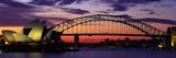 Sydney Harbour Bridge bij zonsondergang, Australië Fotoprint van Panoramic Images,