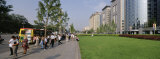 Tourists on a Road Side in Front of Buildings, Oriental Plaza, Beijing, China Photographic Print by  Panoramic Images