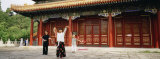 Two Women and a Man Dancing in Front of a Building, the Coal Hill Park, Beijing, China Photographic Print by Panoramic Images