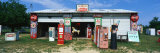 Vintage Signs on Garage, Texas, USA Photographic Print by Panoramic Images