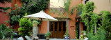 Patio Umbrella in Front of a Building, San Miguel De Allende, Mexico Photographic Print by Panoramic Images