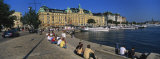 Tourists Sitting on Steps Near a River, Stockholm, Sweden Photographic Print by  Panoramic Images
