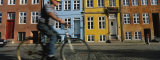 Side Profile of a Man Riding a Bicycle, Copenhagen, Denmark Photographic Print by  Panoramic Images