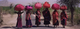 Women Standing on a Road with Luggage on Their Head, Siana, Jodhpur, Rajasthan, India Photographic Print by  Panoramic Images