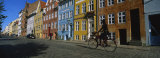 Woman Riding a Bicycle, Copenhagen, Denmark Photographic Print by  Panoramic Images