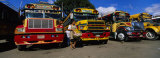 Buses Parked in a Row at a Bus Station, Antigua, Guatemala Photographic Print by Panoramic Images