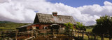 Fence in Front of a Barn, Historical Barn, Collbran, Colorado, USA Photographic Print by  Panoramic Images