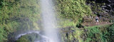 Hiker Taking Photographs of a Waterfall, Kapoloa Falls, Kohala, Hawaii, USA Photographic Print by  Panoramic Images