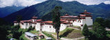 Castle on a Mountain, Trongsar Dzong, Trongsar, Bhutan Photographic Print by  Panoramic Images