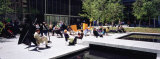 Group of People Sitting Outside a Museum, Museum of Modern Art, New York City, NY, USA Photographic Print by  Panoramic Images