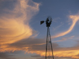 A Lone Windmill Dots the Prairie Landscape Photographic Print by Joel Sartore