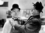 Laurel and Hardy in Tit for Tat Poster by G. Neri
