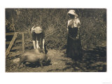 Two Young Women Tend to Pigs in Their Pen Giclee Print