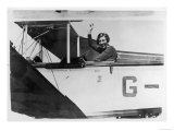 Amy Johnson (Mrs Mollison) Sits in Her Plane and Smiles and Waves to the Camera Giclee Print