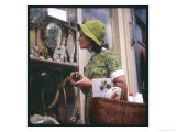 Woman in a Green Floppy Hat and Green Dress Browses in a Shop Selling Various Mirrors and Ornaments Giclee Print
