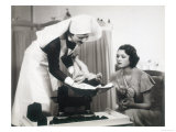 Nurse Weighs a Small Baby While Its Mother Watches Giclee Print
