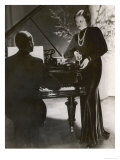 Man Plays a Piano and Looks up at a Glamorous Woman in a Long Dress Lmina gicle