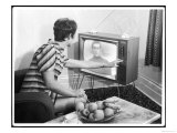 Young Woman with Short Dark Hair Wearing a Stripy Mini Dress Adjusts Her Television Set Giclee Print