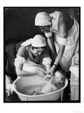Two Nurses Bath a Baby Giclee Print