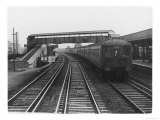 An Electric Train at Raynes Park Station Surrey England Giclee Print