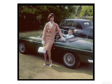 Girl in a Smart Summer Suit Poses Next to Her Boyfriend's MGB Sports Car Reproduction procédé giclée
