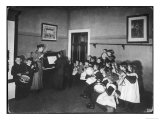 Music Lesson at a German School. One Teacher Plays the Piano Giclee Print