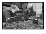Two Blond Boys are Absorbed by Their Model Train Set Giclee Print