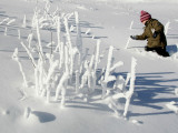 Young Boy Wades Through the Deep Snow at the Arber Mountain in the Bavarian Forest Photographic Print