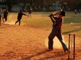 Cricket Batsman Swings on Dusty Pitch, Fort Cochin, India Fotografisk trykk av Anthony Plummer