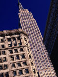 Empire State Building from Herald Square, New York City, New York, USA Photographic Print by Angus Oborn