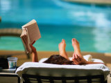 Woman Reading by Hotel Swimming Pool, Las Vegas, Nevada, USA Photographic Print by Ray Laskowitz