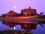 Teutonic Castle of Malbork at Sunset, Malbork, Poland Photographic Print by Krzysztof Dydynski