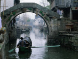 A Bamboo Boat Makes Its Way Through Shaoxing Water Town, Shaoxing, Zhejiang, China Photographic Print by Keren Su