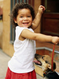 Young Girl with Puppy at Sunday Market, Mataderos, Buenos Aires, Argentina Photographic Print by Michael Taylor