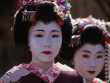 Geisha Girls, Looking at Camera, Kyoto, Japan Photographic Print by Izzet Keribar