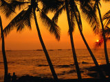 A Couple in Silhouette, Enjoying a Romantic Sunset Beneath the Palm Trees in Kailua-Kona, Hawaii Photographic Print by Ann Cecil