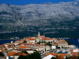 Island Town with Mountain Backdrop, Korcula, Croatia Photographic Print by Wayne Walton