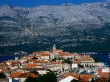 Island Town with Mountain Backdrop, Korcula, Croatia Photographic Print by Wayne Walton