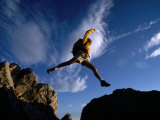 Hiker Jumping Between Rocks in the Wasatch Mountains, Wasatch-Cache National Forest, Utah, USA Photographic Print by Cheyenne Rouse