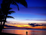 Couple Walking Along Beach at Sunset, Fiji Photographic Print by Peter Hendrie
