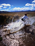 Mountain Biking Across a Creek Near St. Bathans, New Zealand Photographic Print by David Wall