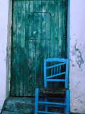 Chair in Front of a Green Door in the Village of Caceres, Caceres, Extremadura, Spain Photographic Print by Jeffrey Becom