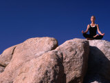 Yoga on the Rocks in the Joshua Tree National Park, California, USA Photographic Print by Cheyenne Rouse