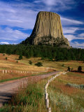 Road Leading to Devil&#39;s Tower National Monument, Wyoming, USA Photographic Print by Carol Polich