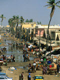 People Going About Their Business in Street, St. Louis, Senegal Photographic Print by Frances Linzee Gordon